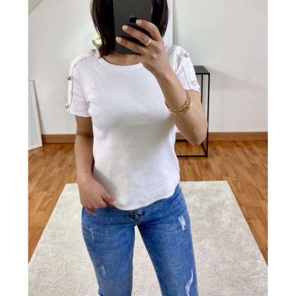 T-shirt blanc à boutons sur les manches
